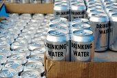 Canned drinking water ready for distribution following a major disaster