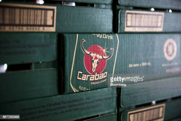 Cases of Carabao energy drink sit inside the warehouse at the Carabao Group Pcl plant in Chachoengsao Chachoengsao Province Thailand on Saturday Dec...