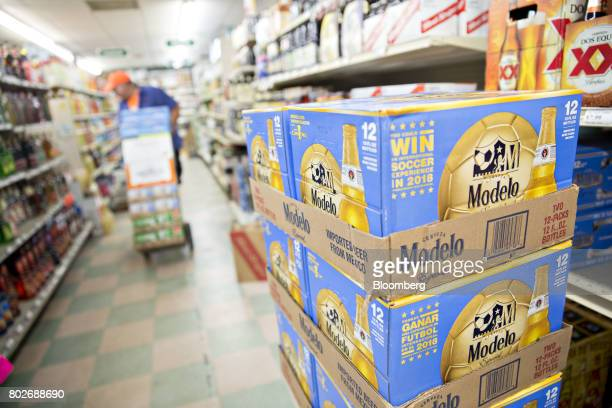 Cases of Constellation Brands Inc Modelo beer sit stacked during a delivery at a liquor store in Ottawa Illinois US on Tuesday June 27 2017...