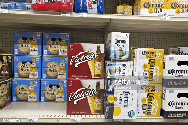 Cases of Constellation Brands Inc Modelo Victoria and Corona beer sit on display for sale at a liquor store in Ottawa Illinois US on Tuesday June 27...