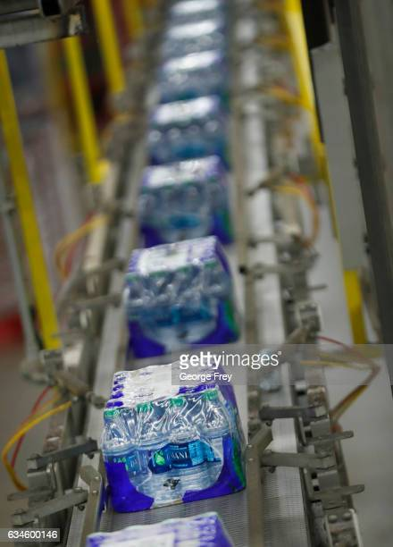 Cases of Dasani bottled water move down a production line at a CocoCola bottling plant on February 10 2017 in Salt Lake City Utah Current Coke...