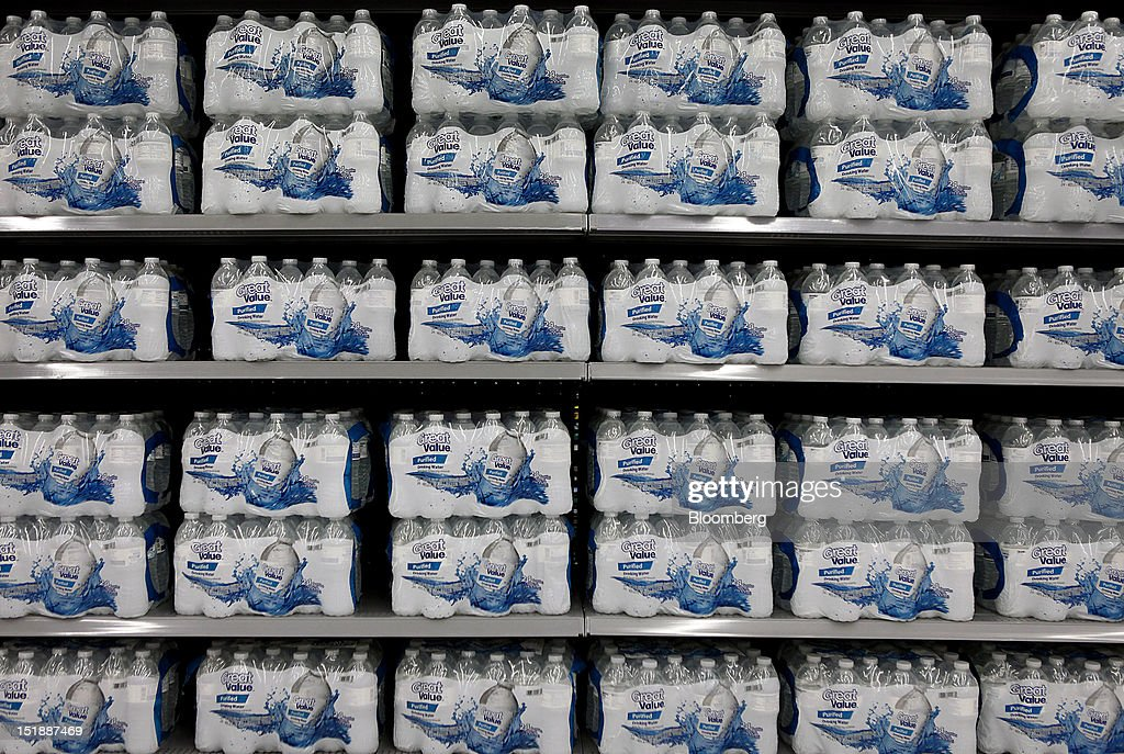 Cases of Great Value brand bottled water are displayed for sale at the grand opening of a new Wal-Mart Stores Inc. location in Torrance, California, U.S., on Wednesday, Sept. 12, 2012. The Wal-Mart store, which was the first location to open in Los Angeles County since 2006, was built inside of a former Mervyn's clothing location. Photographer: Patrick Fallon/Bloomberg via Getty Images