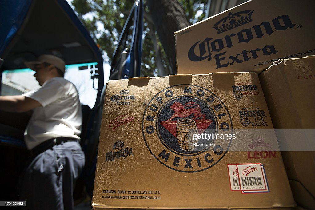 Cases of Grupo Modelo SAB's Corona brand beer sit on the sidewalk during a delivery in Mexico City, Mexico, on Thursday, June 6, 2013. Heineken NV and Grupo Modelo SAB, the dominant brewers in Mexico with brands such as Dos Equis and Corona, are nearing the end of an almost three-year-old government antitrust probe. Photographer: Susana Gonzalez/Bloomberg via Getty Images