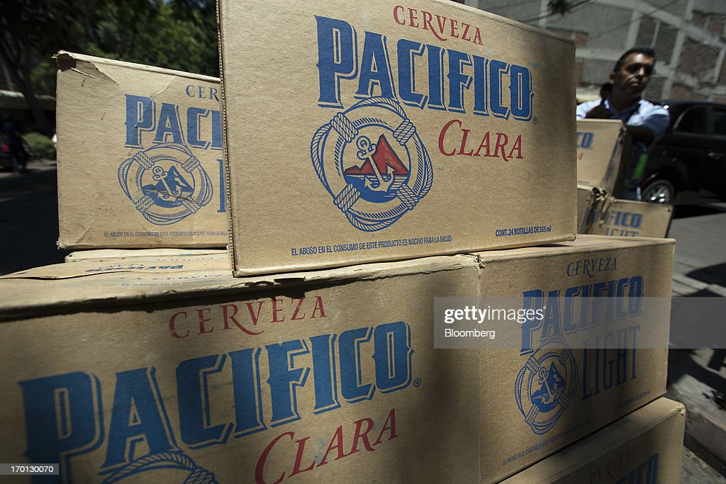 Cases of Grupo Modelo's Pacifico beer sit after being unloaded from a delivery truck in Mexico City, Mexico, on Thursday, June 6, 2013. Heineken NV and Grupo Modelo SAB, the dominant brewers in Mexico with brands such as Dos Equis and Corona, are nearing the end of an almost three-year-old government antitrust probe. Photographer: Susana Gonzalez/Bloomberg via Getty Images
