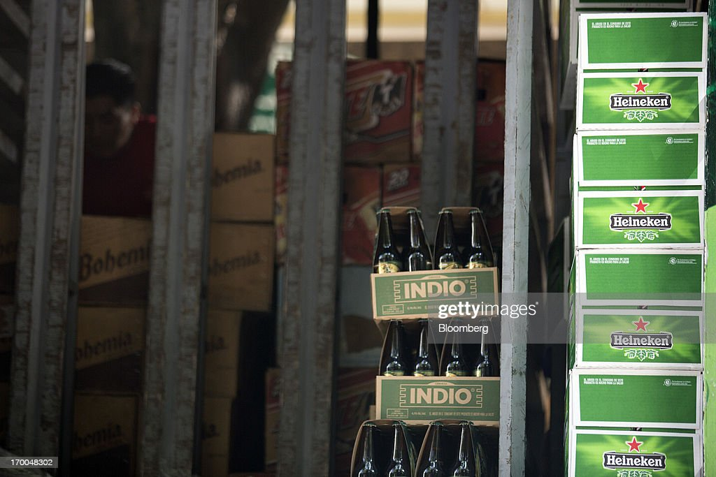 Cases of Heineken NV beer and Indio beer, brewed by Cuauhtemoc-Moctezuma, a subsidiary of Heineken, sit in a delivery truck in Mexico City, Mexico, on Thursday, June 6, 2013. Heineken NV and Grupo Modelo SAB, the dominant brewers in Mexico with brands such as Dos Equis and Corona, are nearing the end of an almost three-year-old government antitrust probe. Photographer: Susana Gonzalez/Bloomberg via Getty Images