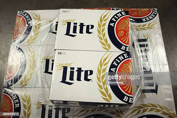 Cases of MillerCoors LLC brand Miller Lite beer sit stacked before being loaded onto trucks at the Stagnaro Distributing Inc facility in Cincinnati...