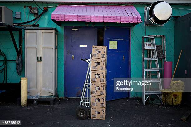 Cases of SABMiller Plc Miller Lite brand beer sit on a hand truck during a delivery in Chillicothe Illinois US on Thursday Sept 17 2015 AnheuserBusch...