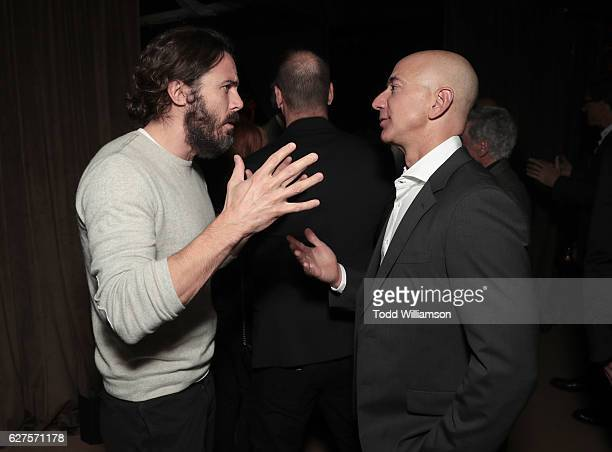 Casey Affleck and Amazon CEO Jeff Bezos attend Jeff Bezos and Matt Damon's 'Manchester By The Sea' Holiday Party on December 3 2016 in Los Angeles...