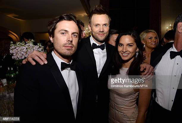 Casey Affleck Joel McHale and Olivia Munn attend the Bloomberg Vanity Fair cocktail reception following the 2014 WHCA Dinner at Villa Firenze on May...