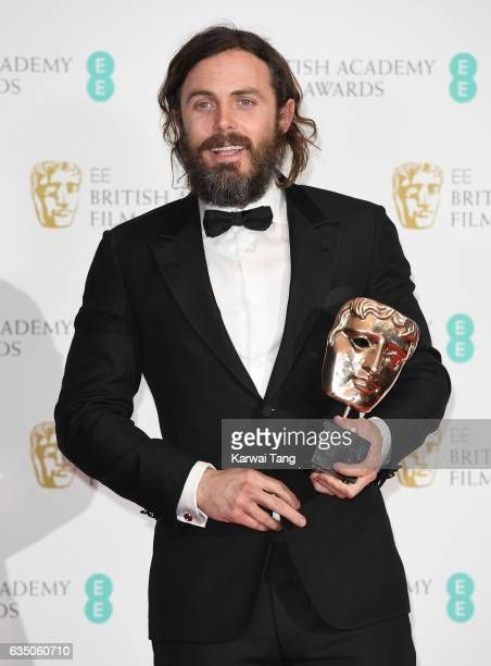 Casey Affleck with his Best Actor award for 'Manchester by the Sea' in the winners room at the 70th EE British Academy Film Awards at the Royal...