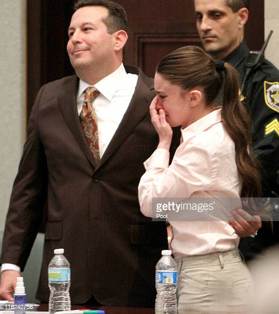 Casey Anthony cries with her attorney Jose Baez after she was acquitted of murder charges at the Orange County Courthouse on July 5 2011 in Orlando...