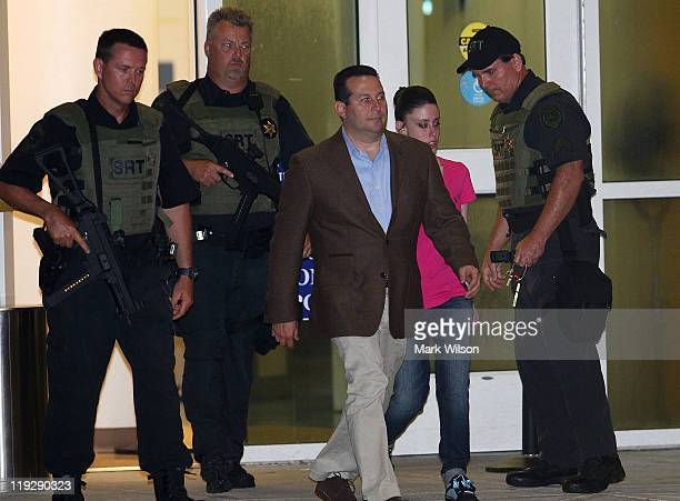 Casey Anthony is surrounded by police as she and her defense attorney Jose Baez leave the Booking and Release Center at the Orange County Jail after...