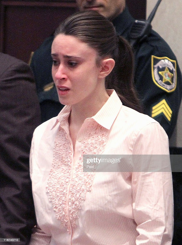 <a gi-track='captionPersonalityLinkClicked' href=/galleries/search?phrase=Casey+Anthony&family=editorial&specificpeople=7188333 ng-click='$event.stopPropagation()'>Casey Anthony</a> reacts to being found not guilty on murder charges at the Orange County Courthouse on July 5, 2011 in Orlando, Florida. At left is her attorney Jose Baez. On the right is attorney Dorothy Clay Sims. <a gi-track='captionPersonalityLinkClicked' href=/galleries/search?phrase=Casey+Anthony&family=editorial&specificpeople=7188333 ng-click='$event.stopPropagation()'>Casey Anthony</a> had been accused of murdering her two-year-old daughter Caylee in 2008.
