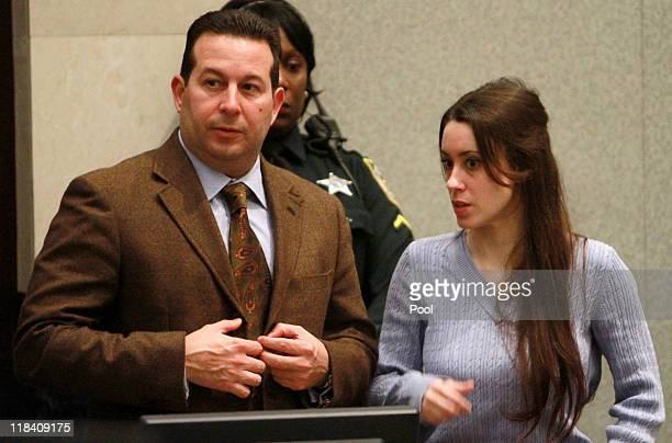 Casey Anthony stands with her attorney Jose Baez during her sentencing hearing on charges of lying to a law enforcement officer at the Orange County...