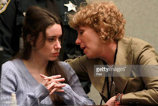 Casey Anthony talks with her attorney Dorothy Clay Sims during her sentencing hearing on charges of lying to a law enforcement officer at the Orange...