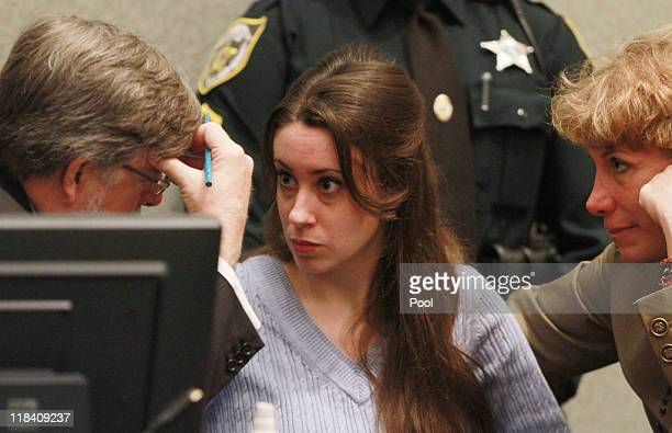 Casey Anthony talks with her attorneys Cheney Mason and Dorothy Clay Sims before the start of her sentencing hearing on charges of lying to a law...