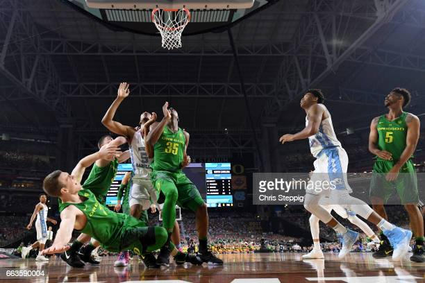 Casey Benson of the Oregon Ducks falls backwards as players look for a rebound during the 2017 NCAA Men's Final Four Semifinal against the North...