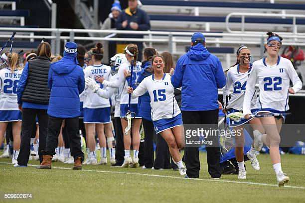Casey Black and Charlotte Tucci of the Duke Blue Devils are introduced prior to the game against the Northwestern Wildcats at Koskinen Stadium on...