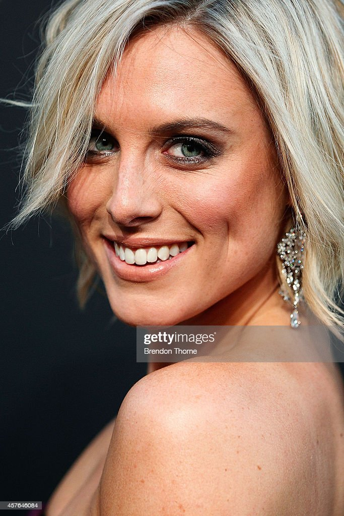 Casey Burgess poses at WHO's sexiest people party 2014 at Fox Studios on October 22 2014 in Sydney Australia