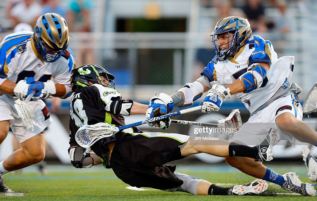 Casey Cittadino #5 of the Charlotte Hounds in action against Stephen Berger #13 of the New York Lizards during their Major League Lacrosse game at Shuart Stadium on May 31, 2013 in Uniondale, New York. The Hounds defeated the Lizards 14-12.