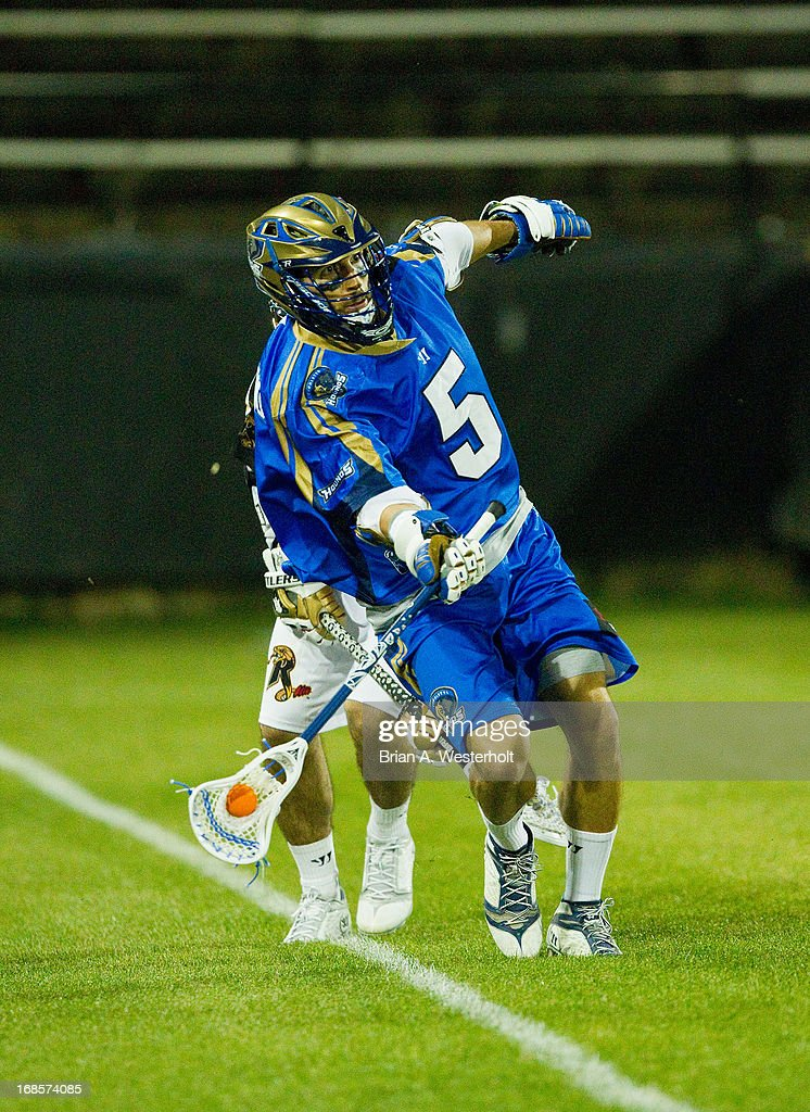 Casey Cittadino #5 of the Charlotte Hounds saves the ball from going out of bounds during second half action against the Rochester Rattlers at American Legion Memorial Stadium on May 11, 2013 in Charlotte, North Carolina. The Rattlers defeated the Hounds 13-10.