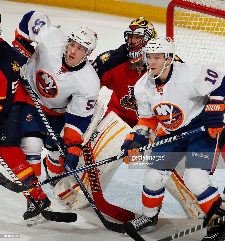 Casey Cizikas #53 and Keith Aucoin #10 of the New York Islanders get into position for a tip in attempt in front of goaltender Scott Clemmensen #30 of the Florida Panthers at the BB&T Center on March 16, 2013 in Sunrise, Florida. The Islanders defeated the Panthers 4-3.