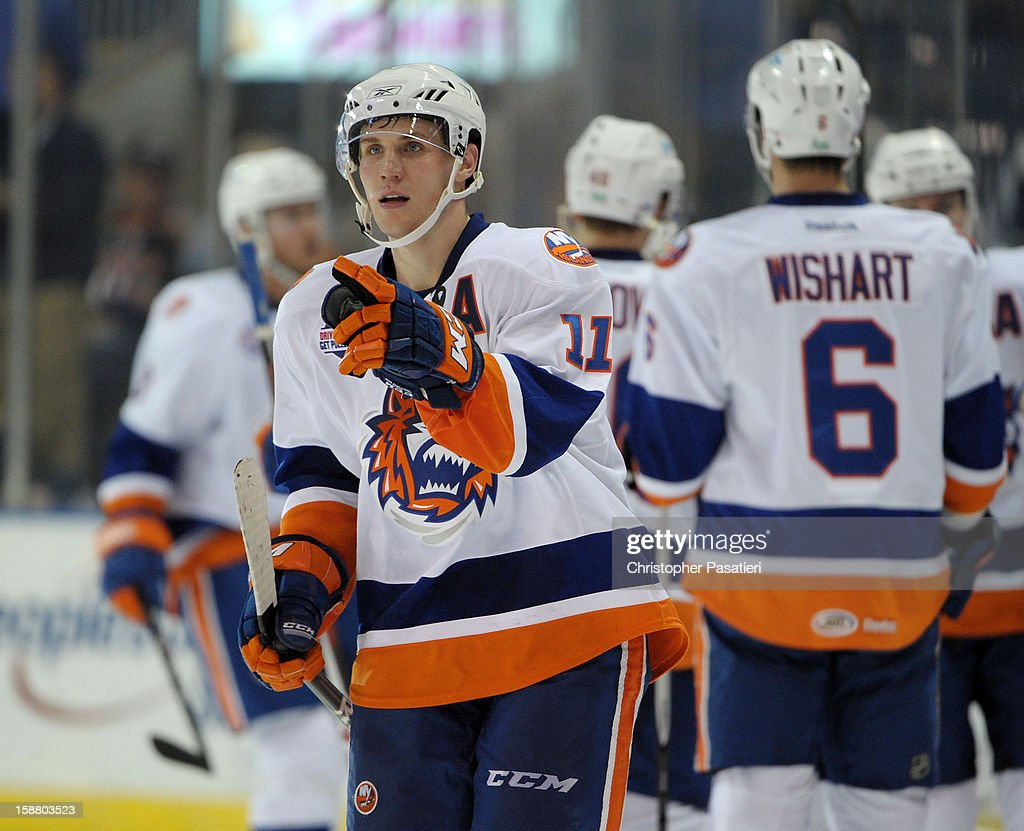 Casey Cizikas #11 of the Bridgeport Sound Tigers points towards his goaltender after scoring a goal during an American Hockey League game against the Manchester Monarchs on December 29, 2012 at the Webster Bank Arena at Harbor Yard in Bridgeport, Connecticut.