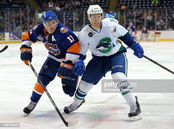 Casey Cizikas of the Bridgeport Sound Tigers skates against Blake Parlett of the Connecticut Whale during an American Hockey League game on December...
