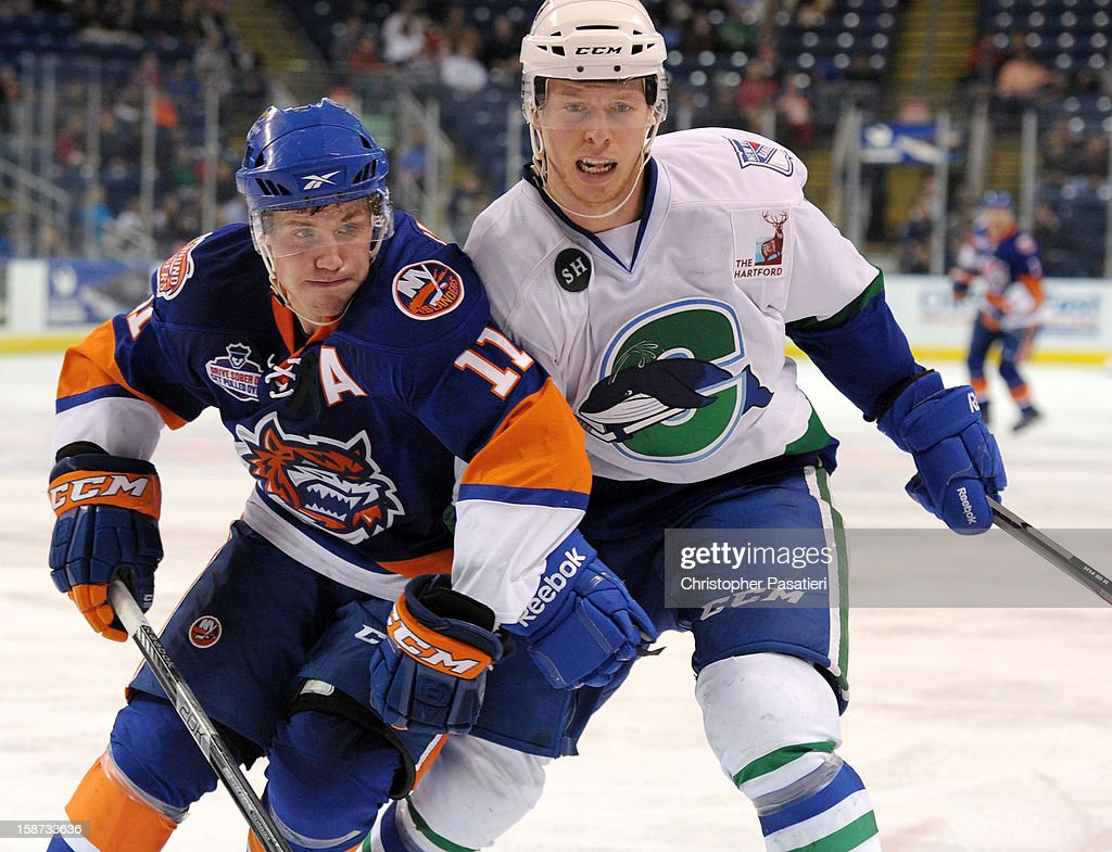 Casey Cizikas #11 of the Bridgeport Sound Tigers skates against Blake Parlett #5 of the Connecticut Whale during an American Hockey League game on December 26, 2012 at the Webster Bank Arena at Harbor Yard in Bridgeport, Connecticut.