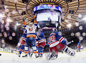 Casey Cizikas of the New York Islanders celebrates a goal by Shane Prince at 1328 of the second period period against Henrik Lundqvist of the New...