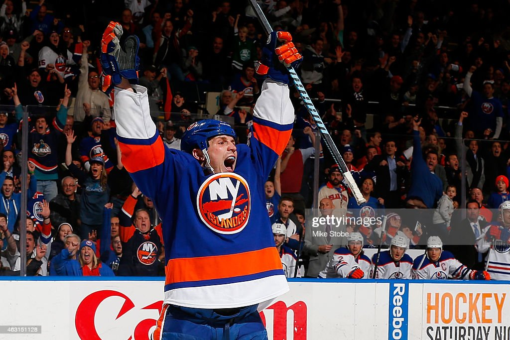 Casey Cizikas #53 of the New York Islanders celebrates after scoring the eventual game winning goal late in the third period against the Edmonton Oilers at Nassau Veterans Memorial Coliseum on February 10, 2015 in Uniondale, New York. The New York Islanders defeated the Edmonton Oilers 3-2.