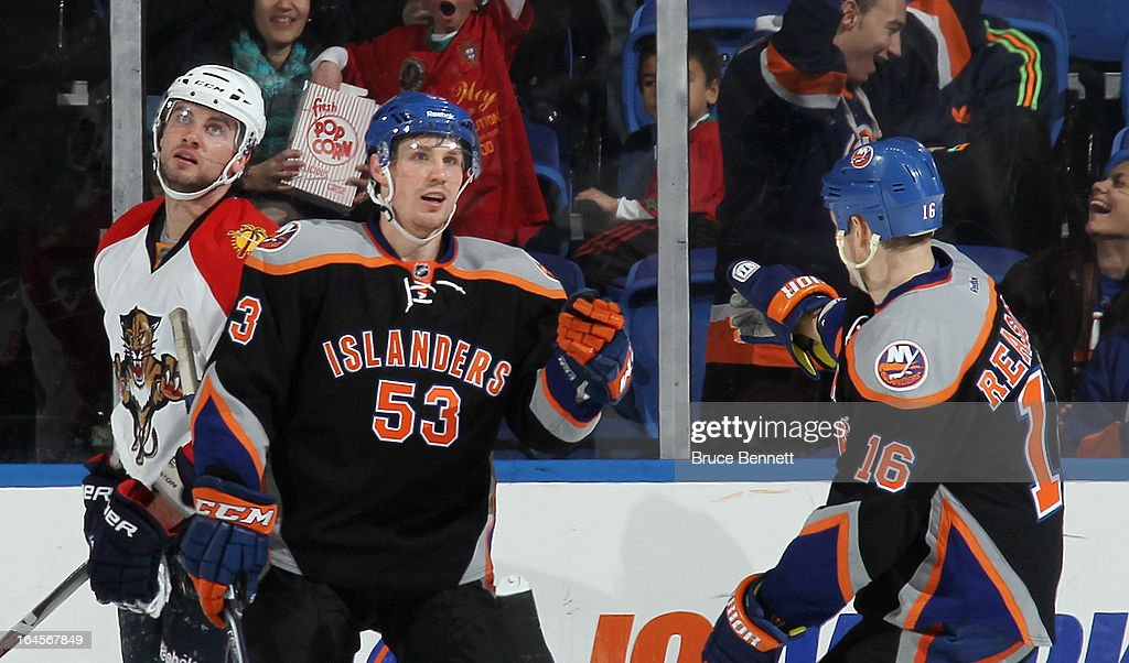 Casey Cizikas of the New York Islanders celebrates his empty net goal against the Florida Panthers along with Marty Reasoner at the Nassau Veterans...