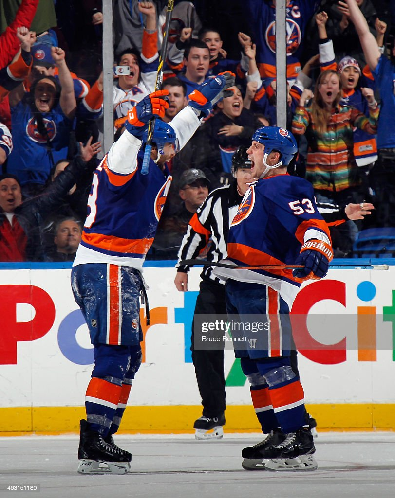Casey Cizikas #53 of the New York Islanders (r) celebrates his game winning goal against the Edmonton Oilers along with Colin McDonald #13 (r) at 15:23 of the third period at the Nassau Veterans Memorial Coliseum on February 10, 2015 in Uniondale, New York. The Islanders defeated the Oilers 3-2.