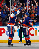 Casey Cizikas of the New York Islanders celebrates his game winning goal against the Edmonton Oilers along with Colin McDonald at 1523 of the third...