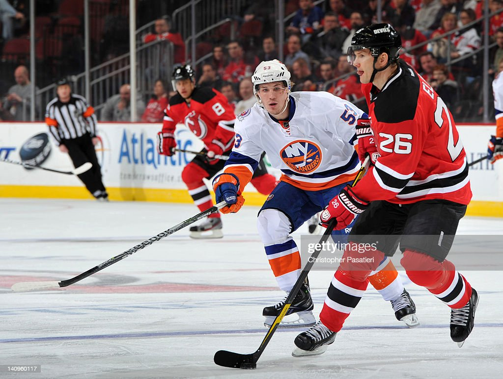 Casey Cizikas #53 of the New York Islanders challenges <a gi-track='captionPersonalityLinkClicked' href=/galleries/search?phrase=Patrik+Elias&family=editorial&specificpeople=201827 ng-click='$event.stopPropagation()'>Patrik Elias</a> #26 of the New Jersey Devils for the puck during the first period on March 8, 2012 at the Prudential Center in Newark, New Jersey.