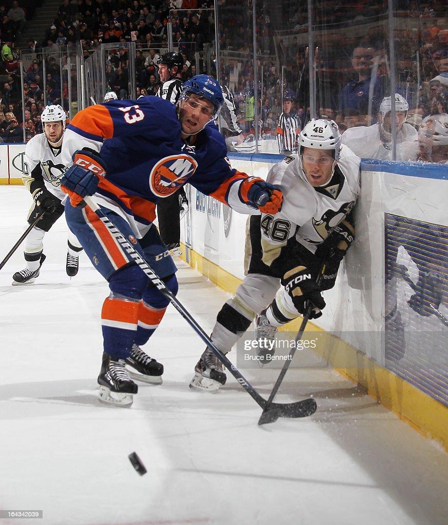 Casey Cizikas #53 of the New York Islanders checks Joe Vitale #46 of the Pittsburgh Penguins at Nassau Veterans Memorial Coliseum on March 22, 2013 in Uniondale, New York.