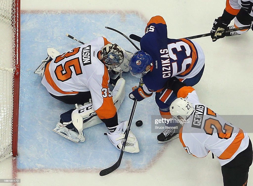 Casey Cizikas #53 of the New York Islanders is stopped by Steve Mason #35 of the Philadelphia Flyers at the Nassau Veterans Memorial Coliseum on April 9, 2013 in Uniondale, New York. The Islanders defeated the Flyers 4-1.