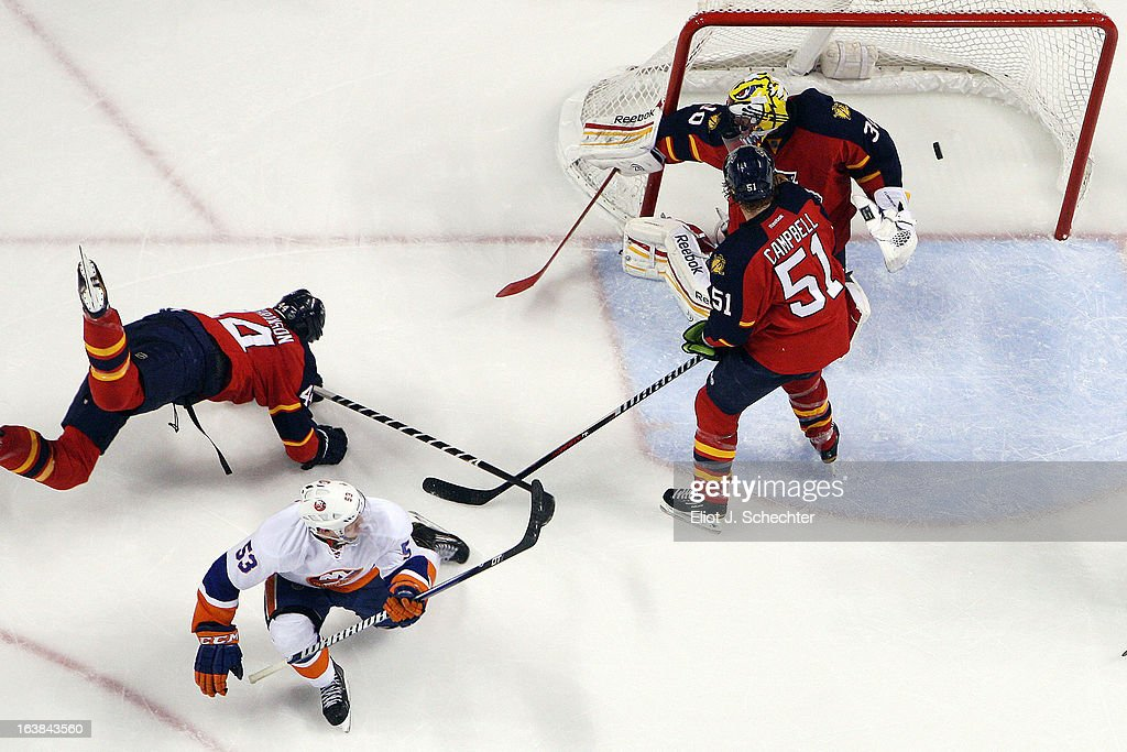 Casey Cizikas #53 of the New York Islanders shoots and scores the game-winning goal against Goaltender Scott Clemmensen #30 of the Florida Panthers at the BB&T Center on March 16, 2013 in Sunrise, Florida.