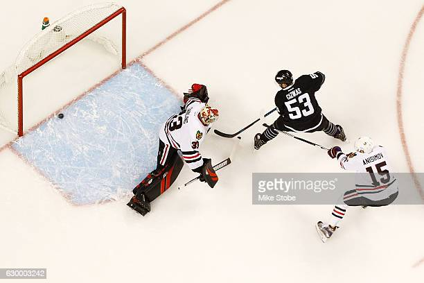 Casey Cizikas of the New York Islanders shots the puck past Scott Darling of the Chicago Blackhawks for a first period goal at the Barclays Center on...