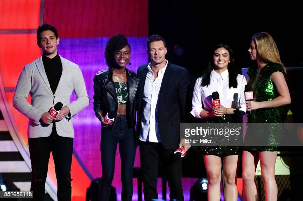 Casey Cott Ashleigh Murray Ryan Seacrest Camila Mendes and Lili Reinhart speak onstage during the 2017 iHeartRadio Music Festival at TMobile Arena on...