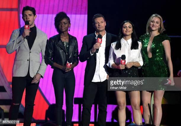 Casey Cott Ashleigh Murray Ryan Seacrest Camila Mendes and Lili Reinhart speak during the 2017 iHeartRadio Music Festival at TMobile Arena on...