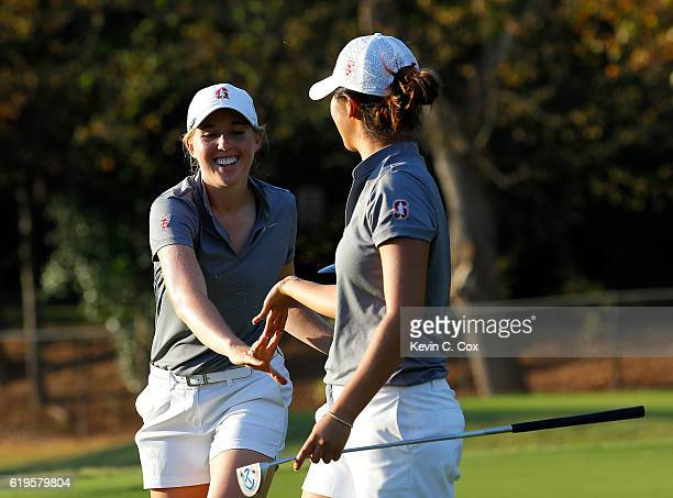 Casey Danielson and teammate Andrea Lee of Stanford react after tying the fourth playoff hole on the 11th green during day 1 of the 2016 East Lake...
