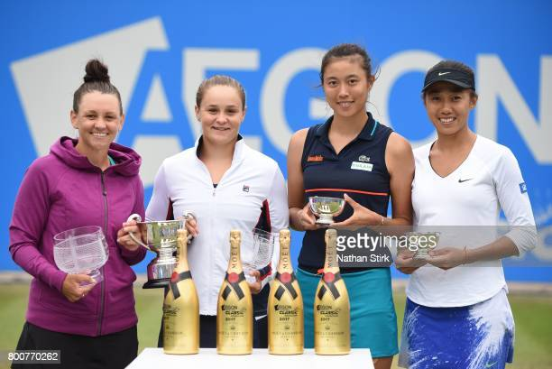 Casey Dellacqua and Ashleigh Barty of Australia Chan HaoChing of Taiwan and Zhang Shuai of China pose with there trophies after the doubles final of...