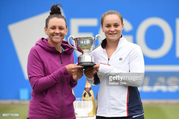 Casey Dellacqua and Ashleigh Barty of Australia hold the doubles Aegon Classic trophy after they beat Chan HaoChing of Taiwan and Zhang Shuai of...