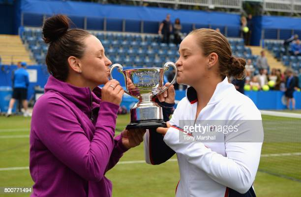 Casey Dellacqua and Ashleigh Barty of Australia kiss the trophy after winning the doubles final during the Aegon Classic Birmingham Final at...