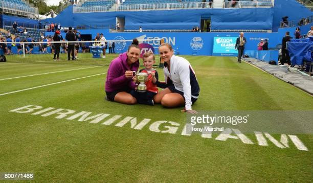 Casey Dellacqua and Ashleigh Barty of Australia pose with the trophy after winning the doubles final during the Aegon Classic Birmingham Final at...