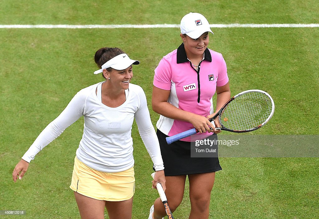 <a gi-track='captionPersonalityLinkClicked' href=/galleries/search?phrase=Casey+Dellacqua&family=editorial&specificpeople=575797 ng-click='$event.stopPropagation()'>Casey Dellacqua</a> (L) and <a gi-track='captionPersonalityLinkClicked' href=/galleries/search?phrase=Ashleigh+Barty&family=editorial&specificpeople=7369424 ng-click='$event.stopPropagation()'>Ashleigh Barty</a> (R) of Australia smile during their match against Caroline Garcia of France and Shuai Zhang of China on day six of the Aegon Classic at Edgbaston Priory Club on June 13, 2014 in Birmingham, England.