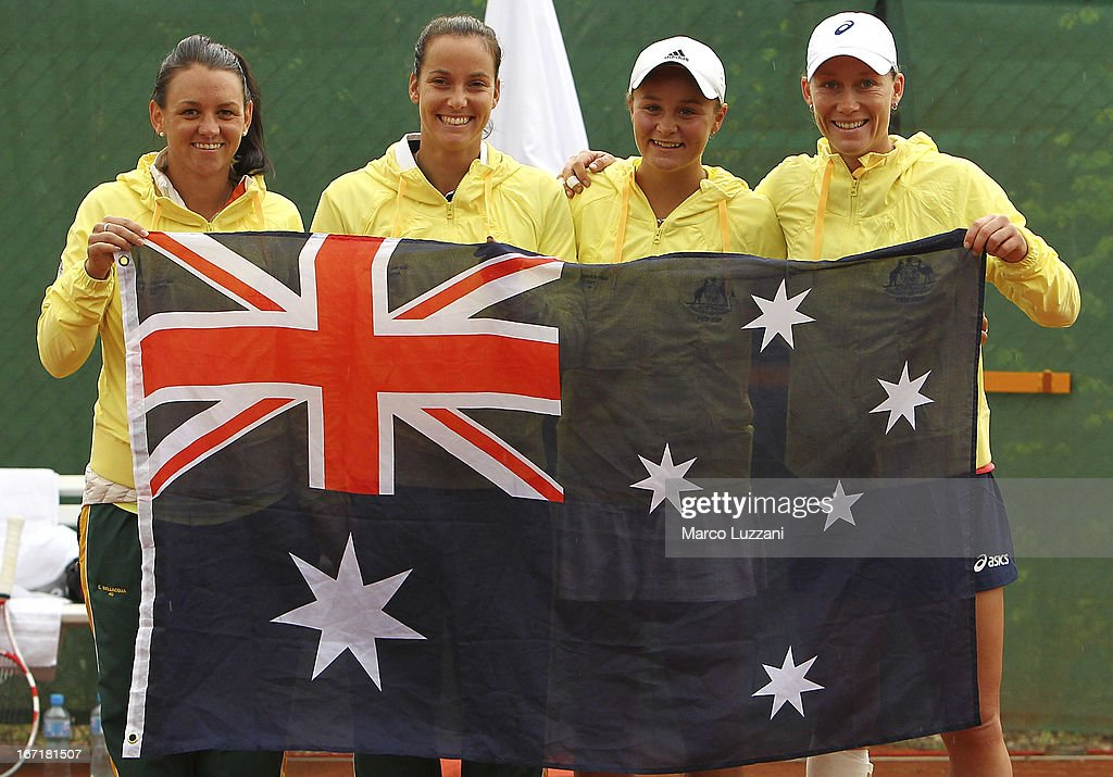 <a gi-track='captionPersonalityLinkClicked' href=/galleries/search?phrase=Casey+Dellacqua&family=editorial&specificpeople=575797 ng-click='$event.stopPropagation()'>Casey Dellacqua</a>, Jarmila Gajdosova, <a gi-track='captionPersonalityLinkClicked' href=/galleries/search?phrase=Ashleigh+Barty&family=editorial&specificpeople=7369424 ng-click='$event.stopPropagation()'>Ashleigh Barty</a> and <a gi-track='captionPersonalityLinkClicked' href=/galleries/search?phrase=Samantha+Stosur&family=editorial&specificpeople=194778 ng-click='$event.stopPropagation()'>Samantha Stosur</a> of Australia celebrate its victory over Switzerland during day two of the Fed Cup World Group Play-Offs between Switzerland and Australia at Tennis Club Chiasso on April 22, 2013 in Chiasso, Switzerland.
