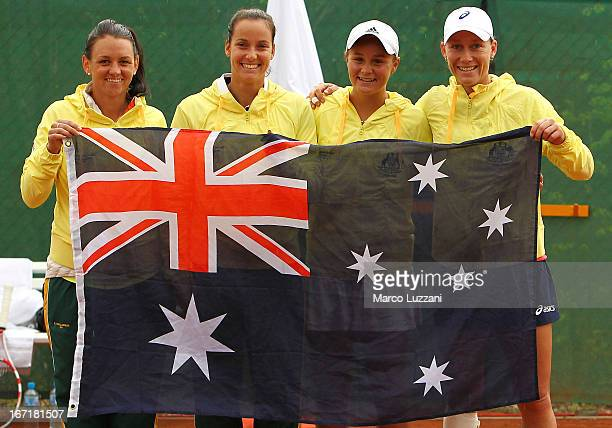 Casey Dellacqua Jarmila Gajdosova Ashleigh Barty and Samantha Stosur of Australia celebrate its victory over Switzerland during day two of the Fed...