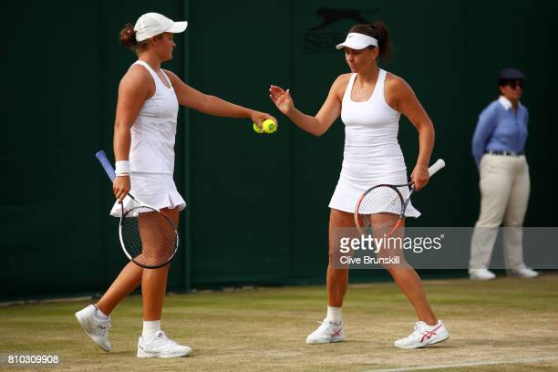 Casey Dellacqua of Australia and Ashleigh Barty of Australia celebrate during the Mixed Doubles first round match against ChiaJung Chuan of Taipei...